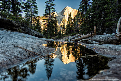 Half Dome reflected in the creek next to camp