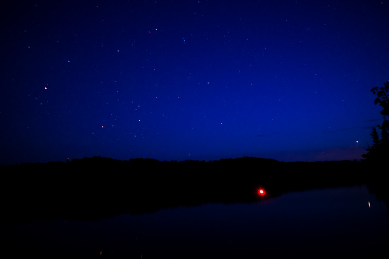 Light up bobber fishing under the night sky