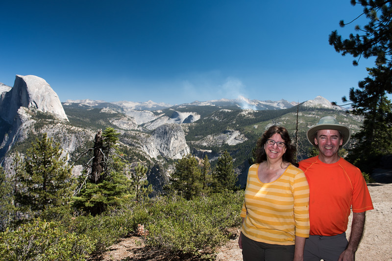 Peter and Teresa at Glacier Point; small fire in the distance.