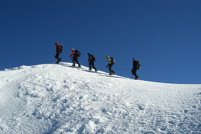 "A climbing party along the Summit ridge heading for the ""Old Shute"""