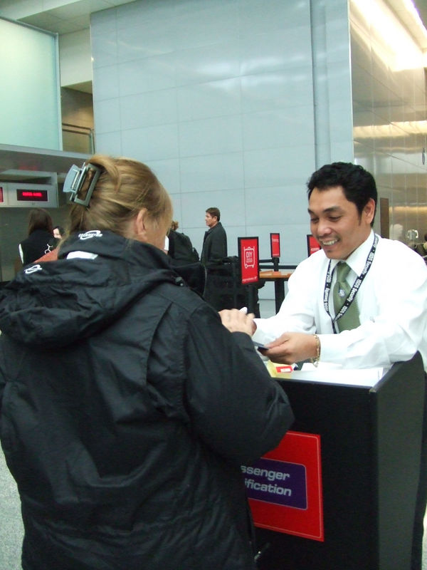Mom being checked at security...look how happy he is to give her a sticker!