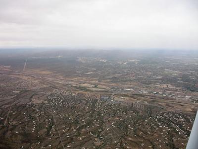 The berg of Tucson slides beneath us.
