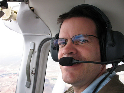 Todd trying his hand at piloting an airplane.