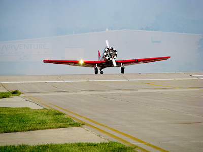 One of the Aeroshell T6's lined up for takeoff during the daily airshow.