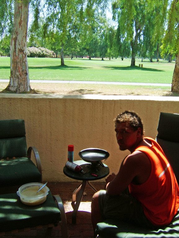 <h3>34. Making Pancakes Near the Ninth Tee</h3> <br> We're out of our element; this much I know.<br> The grass here is nowhere as tall as it grows,<br> And everyone round us has much better clothes,<br> But hey, at least they don't stare.<br> <br> But one thing surprises me at the resort,<br> With rich people golfing and three tennis courts,<br> And catered amenities we can't afford,<br> For pancake production, there isn't a stove!<br>