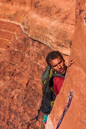 Concentration shows in Kelsey's face as he works his own way past the frightening moves of the traverse.