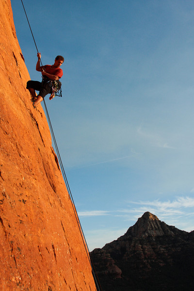 Kelsey rappels overlooking the incredible scenery as the day's climbing draws to a close.
