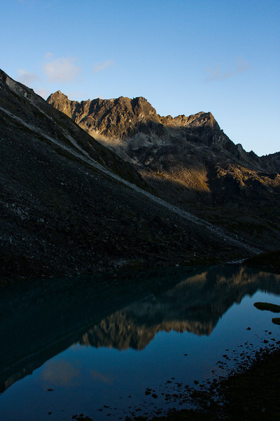 Lower Reed Lake rests peacefully in the arms of the Talkeetna Mountains as the last rays of the sun slip from the peaks.