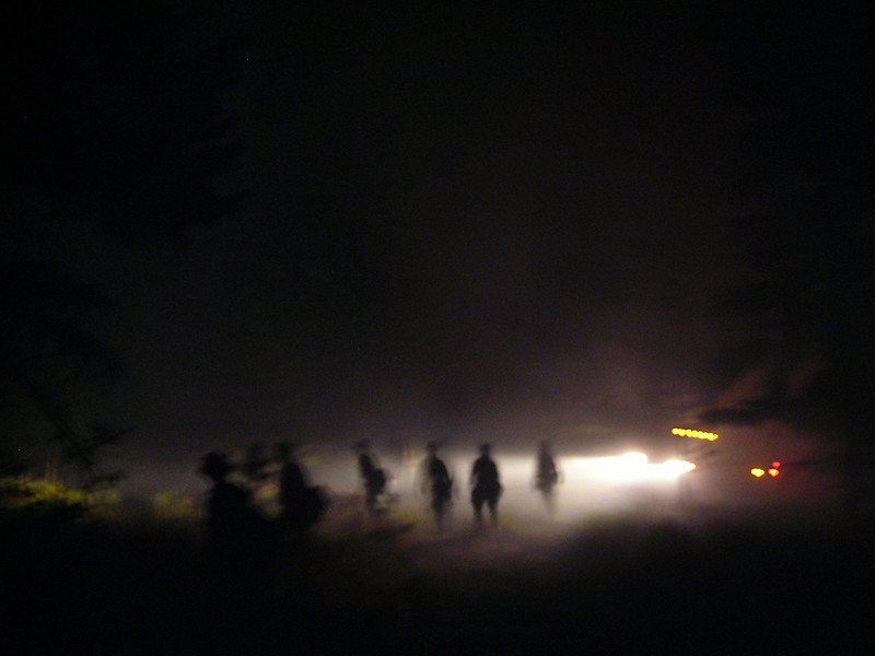 A tired and well worked crew walks the fireline back to the road at the end of a day of backburning.