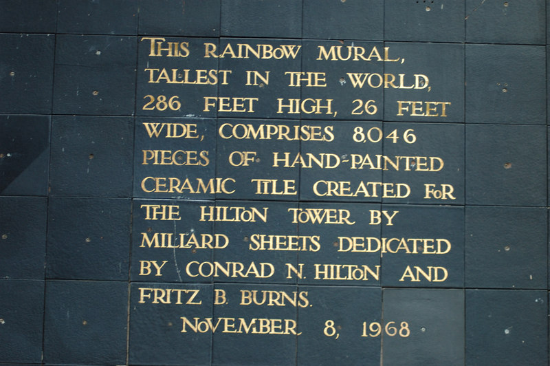 This rainbow mural, tallest in the world, 286 feet high, 26 feet wide, comprises 8,046 pieces of hand-painted ceramic tile created for the Hilton Tower by Millard Sheets, dedicated by Conrad N. Hilton and Fritz B. Burns.<br /> <br /> November 8, 1968