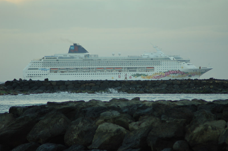 Pride of Aloha pulling into port near sunrise