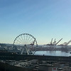Skyline from the north end of Pike Place Market, Mt. Rainier in the distance beyond the Seahawks stadium