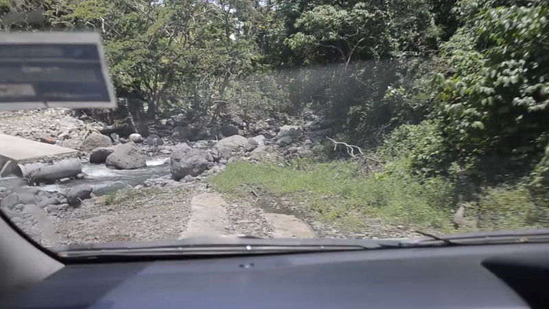 Crossing a river near Navilawa Village. You can see the bridge was washed away.