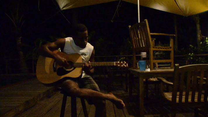 Bill from Blue Water Lodge in New Town playing a traditional Fijian song. Nadi, Fiji.