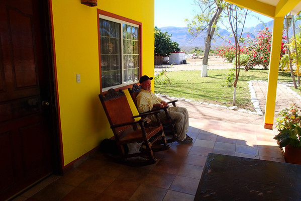David relaxing on the porch outside our cabin.