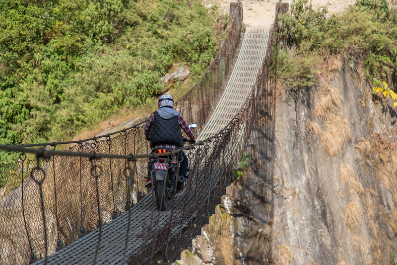 Motorcycle on Suspension Bridge