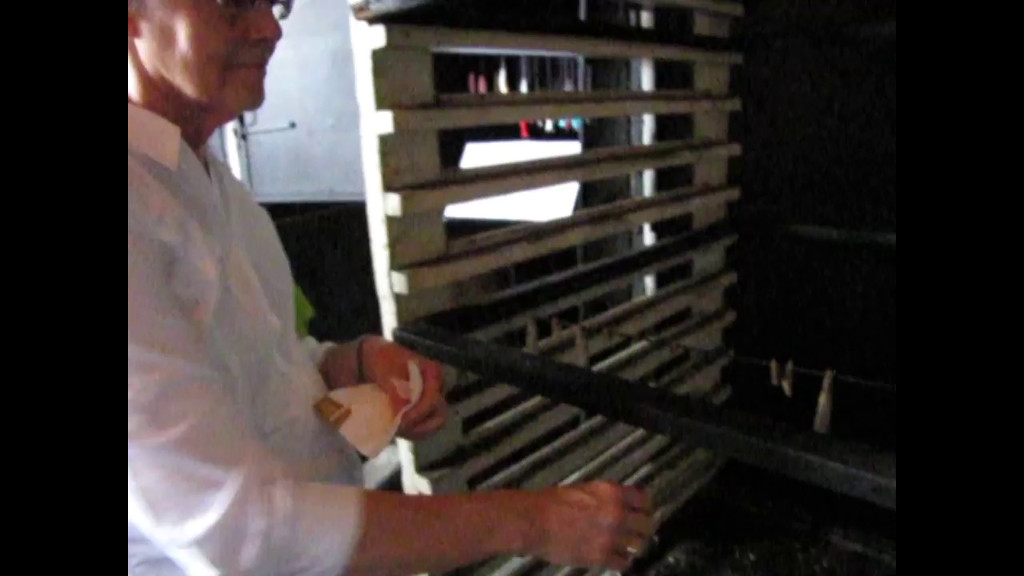Video of Ann  eating a sardine from the oven.