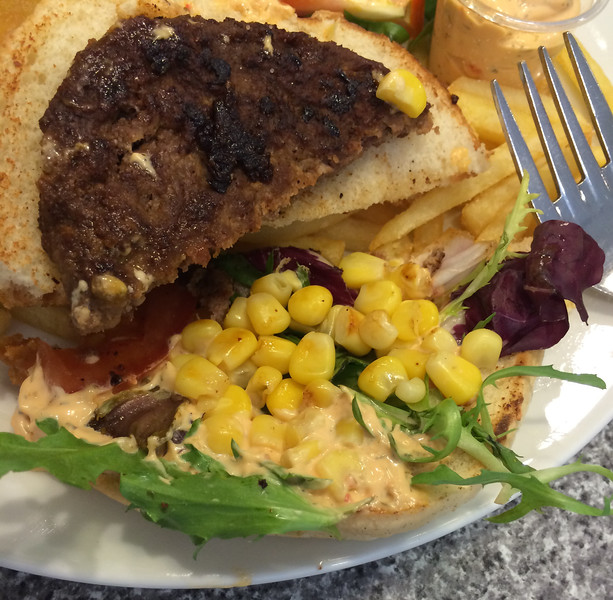 Burgers in Norway came with corn in the sandwich.