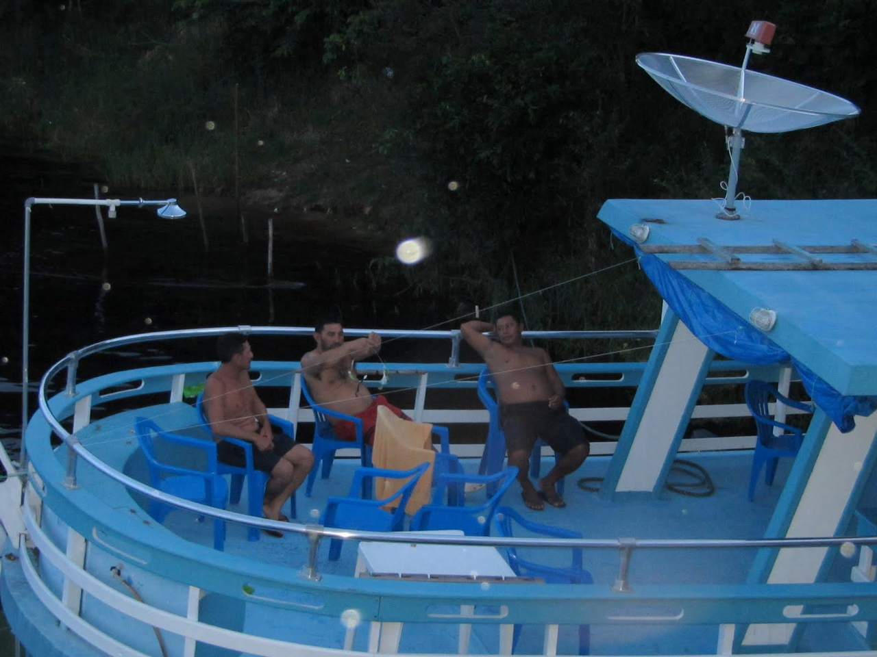 The crew chilling out on their boat