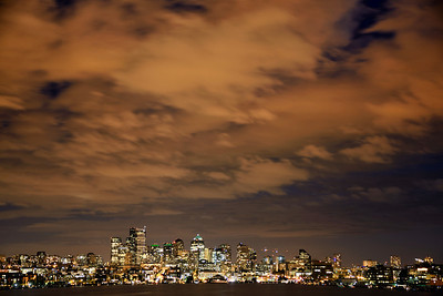The clouds take on the glow of the Seattle city lights!