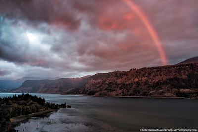 Red rainbow at sunrise over the Columbia River Gorge, from Ruthton State Park.  The rainbow is red only because the suns rays are passing through the lower part of Earth's atmosphere.
