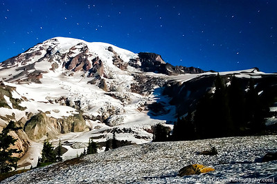 "Mt. Rainier, lit exclusively by ambient moonlight. Taken from Alta Vista (~6,000') at about 11pm.  Nikon D200, Sigma 10-20, at 10mm. 88"" exposure, f/5.0, ISO400, cropped, added contrast and sharpening in CS5."