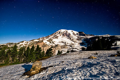 "Mt. Rainier,lit exclusively by ambient moonlight. Taken from Alta Vista (~6,000') at about 11pm.  The ""glow"" on the left skyline is the intrusion of the lights of Seattle-Tacoma. Nikon D200, Sigma 10-20, at 10mm. 129"" exposure, f/5.0, ISO400, added contrast and sharpening in CS5."