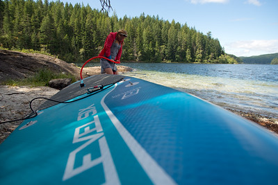 Stand-up paddleboard (SUP) touring in Main Lake Provincial Park, Quadra Island. British Columbia, Canada