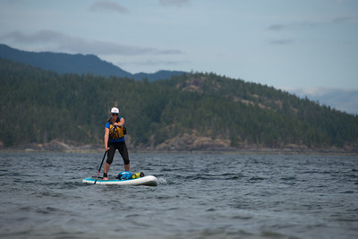 Stand-up paddleboard (SUP) touring in Heriot Bay, Quadra Island. British Columbia, Canada