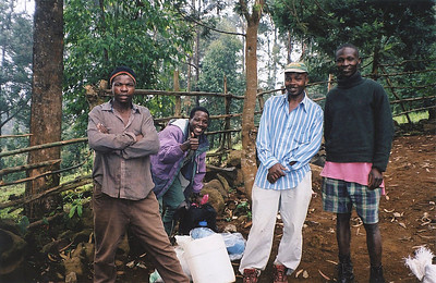 We had 4 porters (one of whom was our cook), and a guide.  To the protestations of our guide, we each carried about 30# on the climb!  The most we say any other munzungo carry was about 10# !!
