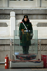 Guard, Tiananmen Square, Beijing.  Notice the fire extinguisher for protestors who may set themselves on fire.