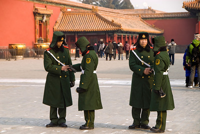 There are guards (and cameras) everywhere in Beijing. I saw the expected guards at the tourist attractions, such as the Forbidden City, here, but also at all banks, parking garages, parks, malls, stores, street corners, etc. The second one from the right is giving my camera the suspicious eye!
