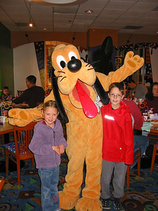 Lexi and Macay with Pluto
