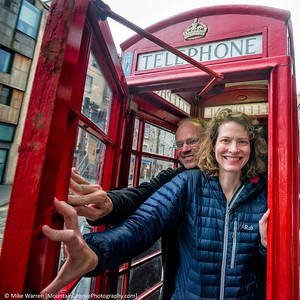 An iconic red telephone booth, throughout the UK