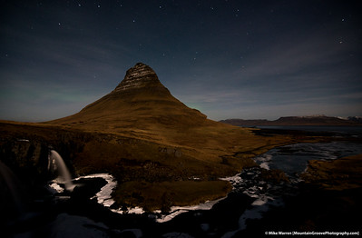 Kirkjufell Mountain, with a hint of Aurora.   The camera caught what the eye could not.