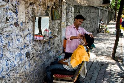 A sidewalk barber!