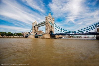 The Tower Bridge, spans the Thames River