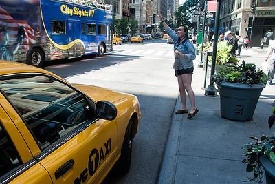 Annie hailing a cab!