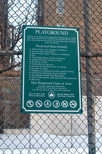 The rules posted on a basketball playground.