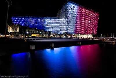 Harpa, the Reykjavik concert hall, in the colors of the French flag, to honor victims of the Paris terrorist attack.