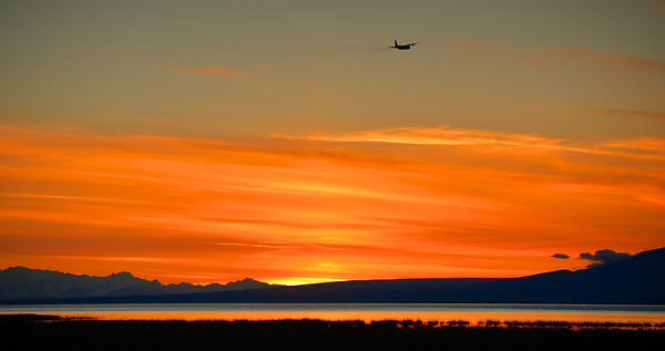 Chasing the light  A plane chases the sun after taking off from the Anchorage International Airport.
