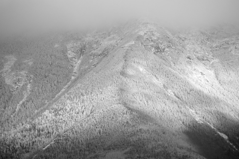 Franconia Ridge covered in clouds as seen from Lonesome Lake