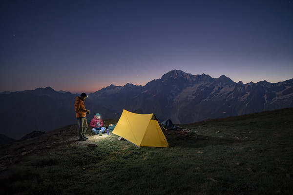Alex Strohl and Valentine Fabre high above the Aosta Valley, Mont Blanc behind.