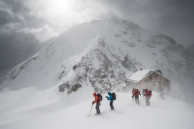 Leaving the Hollandia Hut in a storm, Bernese Oberland