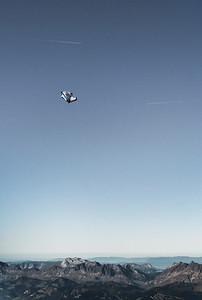 Wingsuiter flying from the Aiguille du Midi. Chaîne des Aravis below. France