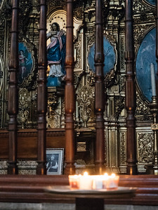 Candles outside a side chapel