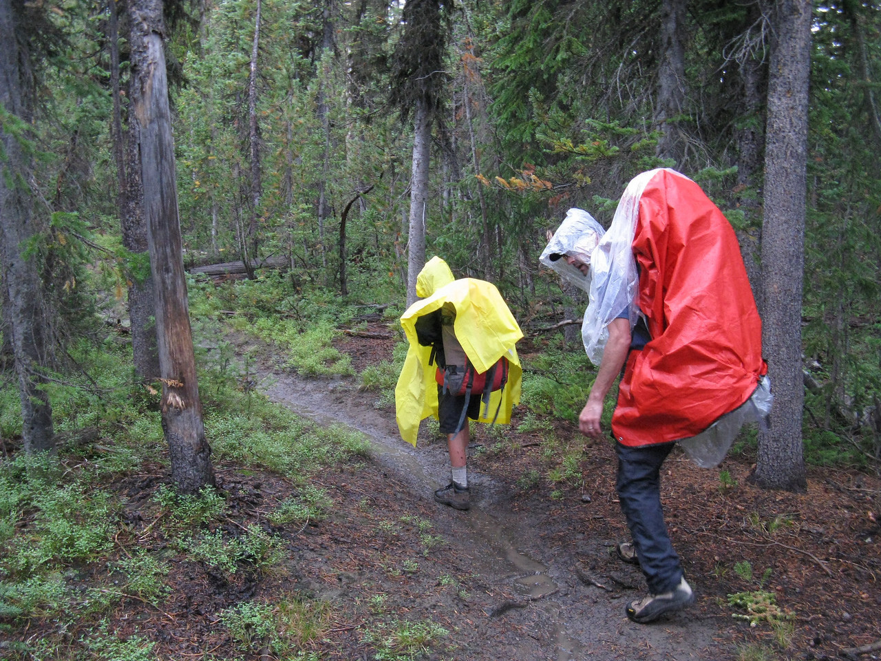 Well - the weather has headed south. .. Kevin has rigged a rain cover for his pack.