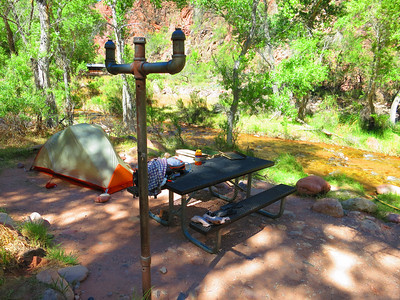 Hey - someone has my tent all set up; note metal picnic tables at each site - Creek just below. The pole is for hanging your backpack away from critters.