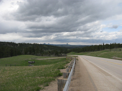 OK, Friday afternoon, 5/15/09, and our (Bill & Brett's) first view of Devils Tower, approaching from the south.  Yep, it was a somewhat rainy day here, though now starting to clear. ... [Our day had begun in Boulder, CO - about a 7.5-hr drive.]