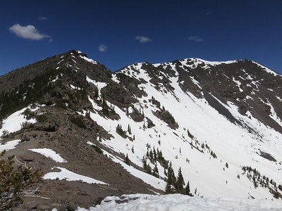 Atop the ridge now, but still a fair walk along it to the summit. .. Note greater snow on north-facing slopes.